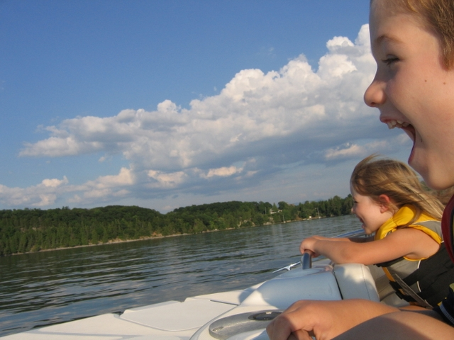 Leo and Sophia enjoy a speedy ride across the lake