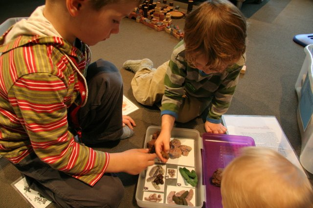 Ben showing Leo the scat collection