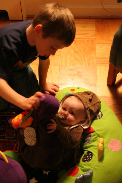 Leo and Liam playing with the octopus