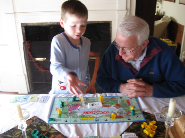 Leo and Grandad playing a mean game of  Monopoly Junior