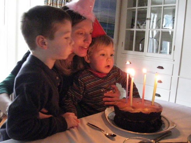 Leo and Finn help blow out the candles